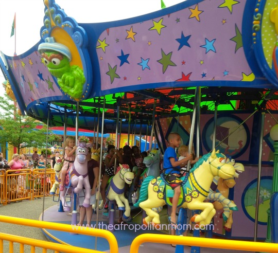 riding the carousel at sesame place