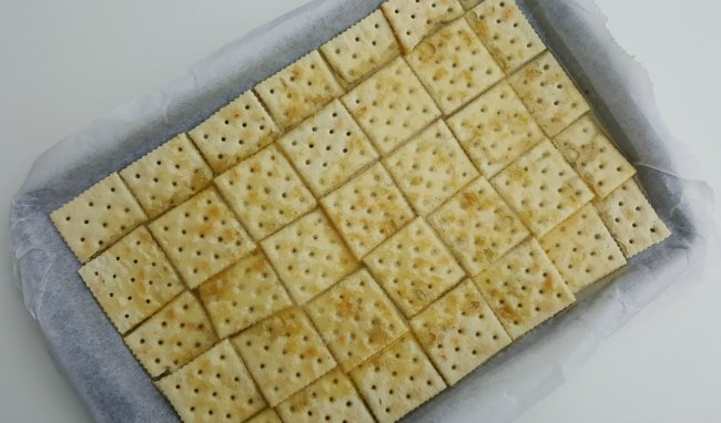 White Chocolate Saltine Toffee melted butter on salted crackers